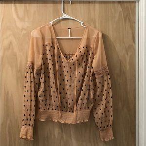 See through polkadot blouse.